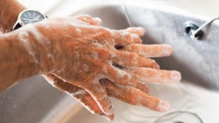 As COVID-19 vaccines come into sight, experts stress on continued handwashing
